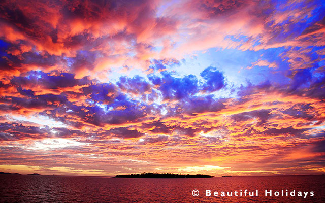 photograph of sunset over uninhabited island in Fiji